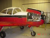 Removing the engine from my flying airplane was difficult, but the engine was tired and we needed more power.  This Navion was the slowest at ANS Convention 2004 at Glenns Falls NY.